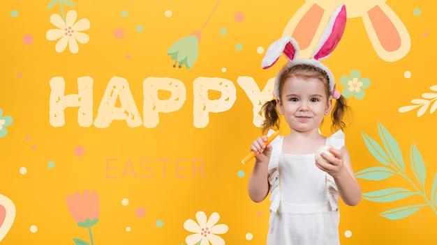 Mockup feliz día de pascua con una niña