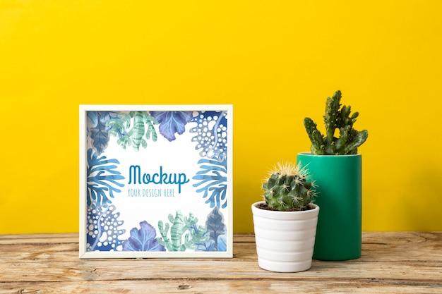 Mockup frame naast planten