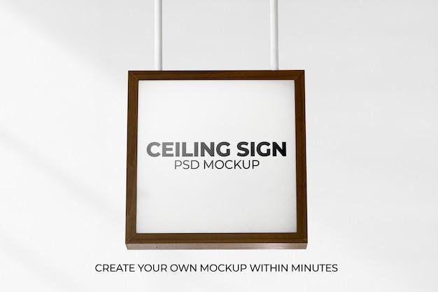 Mockup de letrero enmarcado marrón psd colgando del techo