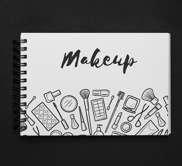 Mockup de  libreta horizontal con dibujo de makeup