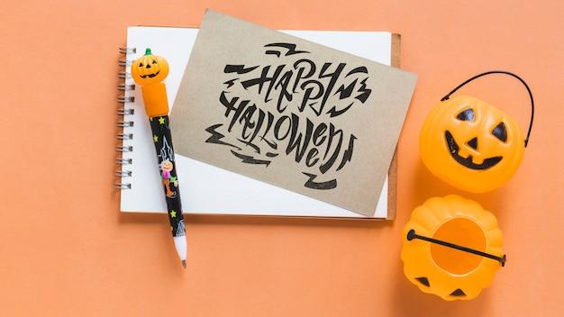 Mockup de libreta y tarjeta de halloween