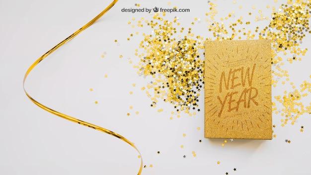 Mockup libro dorado con diseño de navidad