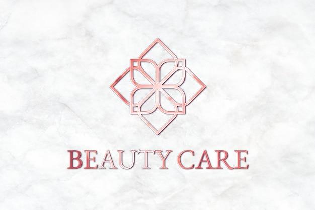 Mockup de logotipo en relieve psd con texto del eslogan de la marca