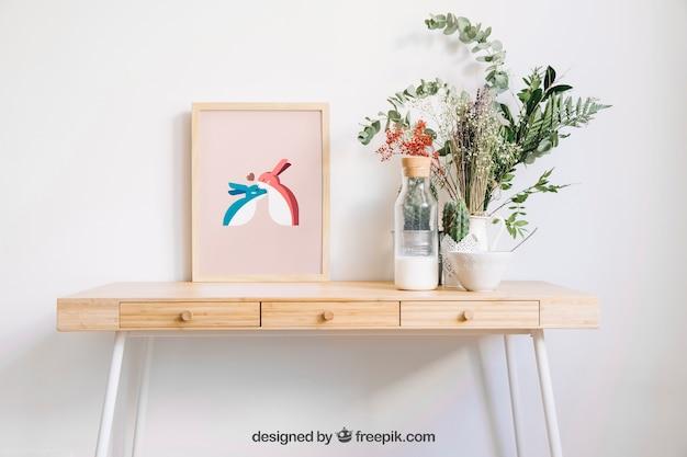 Mockup de marco en mesa con flores