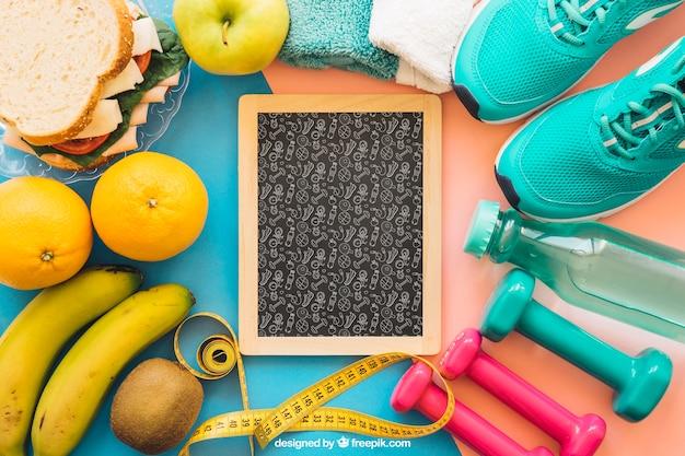 Mockup met leisteen en fitnessspullen