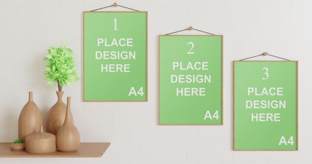 Mockup met meerdere frames aan de muur met houten vaas