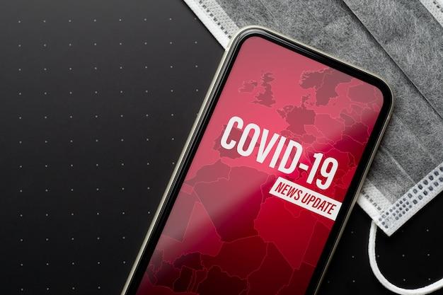 Mockup mobiele telefoon voor coronavirus of covid-19 uitbraak nieuwsupdate achtergrondconcept.