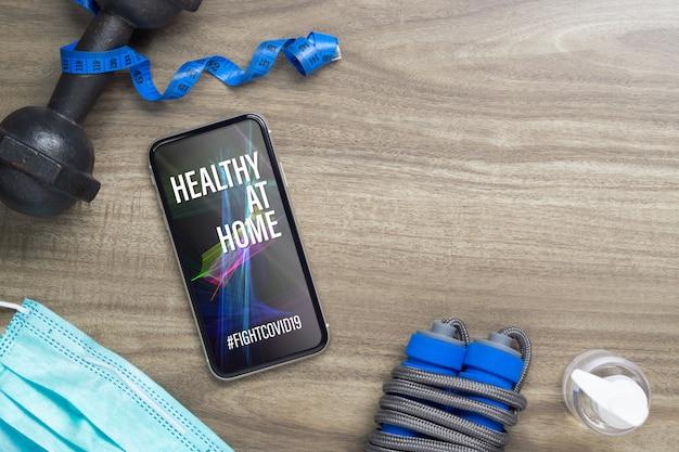 Mockup mobiele telefoon voor gezond thuis voor covid19 quarantainetijden
