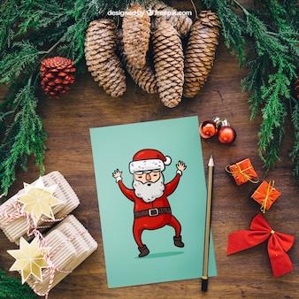 Mockup de navidad con tarjeta de santa