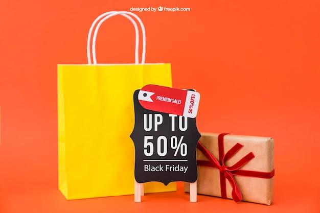 Mockup nero venerdì con borsa e regalo