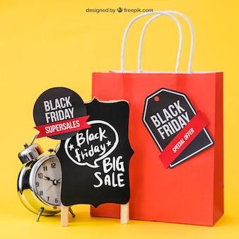 Mockup para black friday con alarma y bolsa