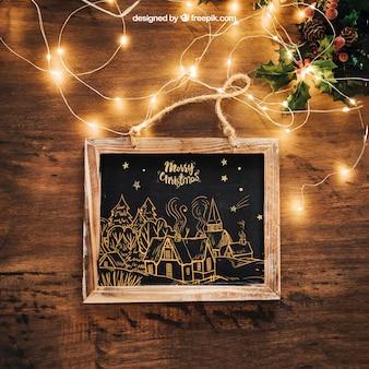 Mockup de pizarra con luces y con diseño de navidad