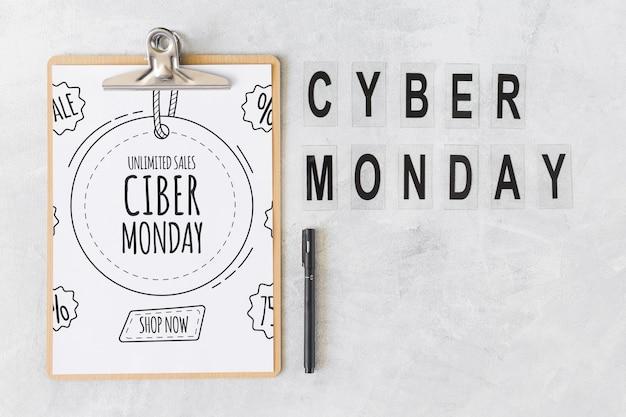 Mockup de portapapeles con letras de cyber monday