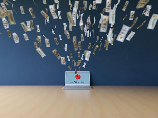 Mockup de portátil con notas de dolares volando hacia él