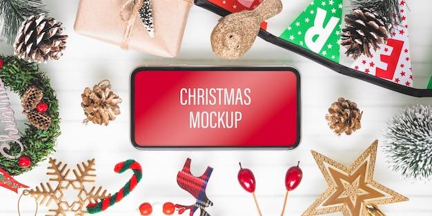 Mockup-smartphone voor kerstmis en nieuwjaar