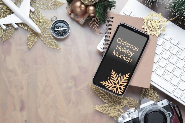 Mockup smartphone voor kerstmis nieuwjaar vakantie reizen achtergrond concept