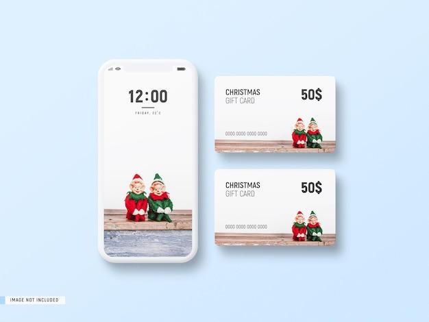 Mockup de tarjeta de regalo de navidad y teléfono minimal blanco