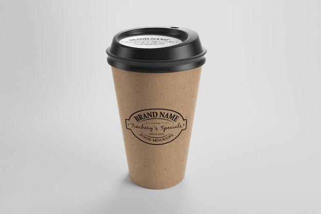 Mockup van bruin papier eco koffiekopje met sticker en dop