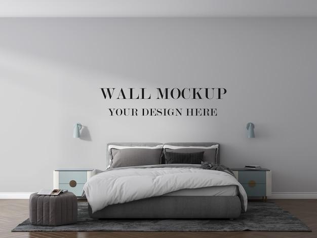 Mockup van de slaapkamermuur met bed en lampen