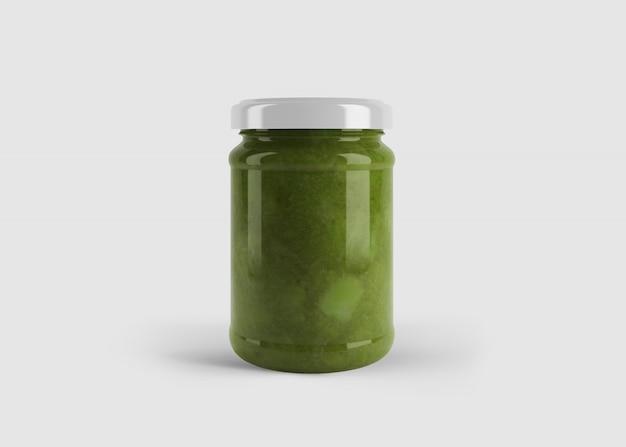 Mockup van groene jam of saus of pesto pot met aangepaste vorm label in schone studio scene