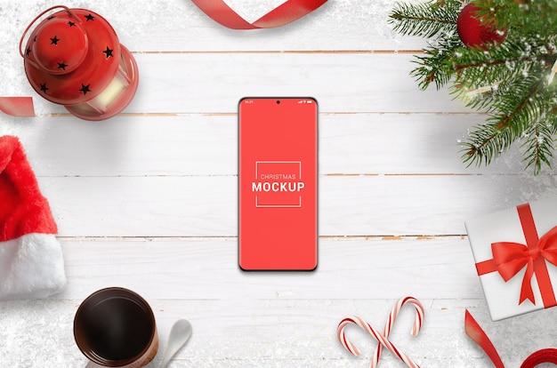 Mockup voor kersttelefoon met maker van decoratiescènes