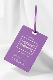 Mockup voor vierkante kledinglabels, vallend
