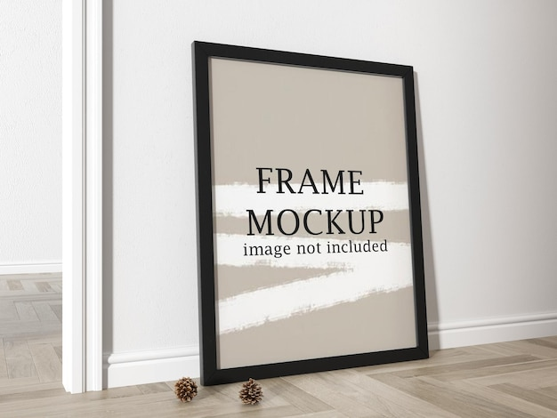 Mockup zwart frame dat tegen muur leunt
