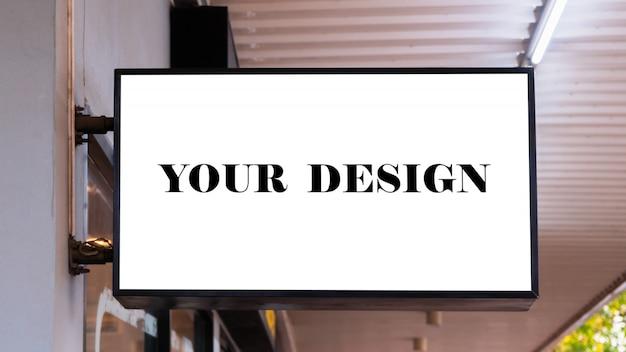 Mockupafbeelding van blanco posters met wit scherm en led buiten storefront