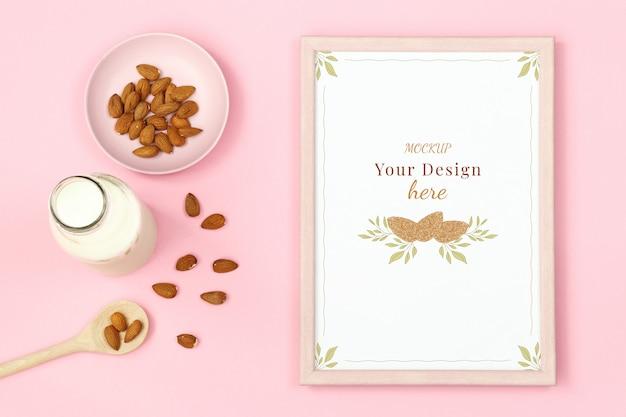 Mockupkader met noten en fles melk op roze achtergrond