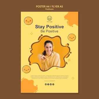 Modello di poster con rimanere positivo