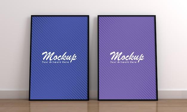 Modern twee verticaal leeg fotolijstmodel op houten vloer