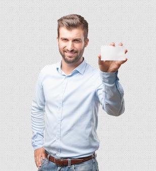 Moderne mens die adreskaartje toont