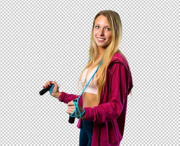 Mooie sportvrouw met touwtjespringen