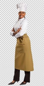 Mooie vrouwelijke chef-kok van de braziliaanse keuken op transparante ruimte