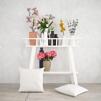 Muebles decorativos blancos con hermosas plantas y maquetas de fundas de almohada