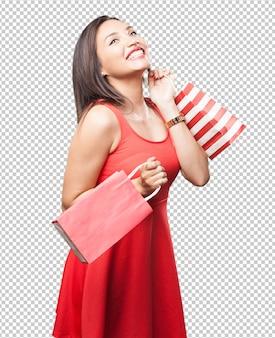 Mujer asiática con bolsas de compras