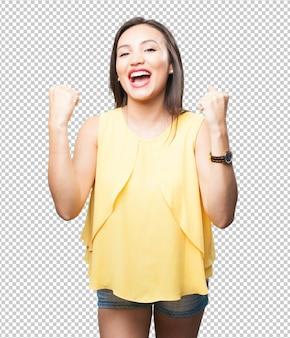Mujer asiática haciendo gesto ganador