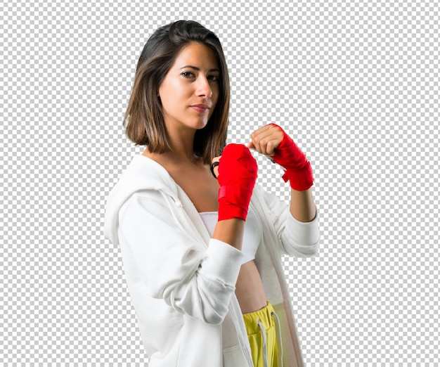 Mujer de deporte con vendajes de boxeo.