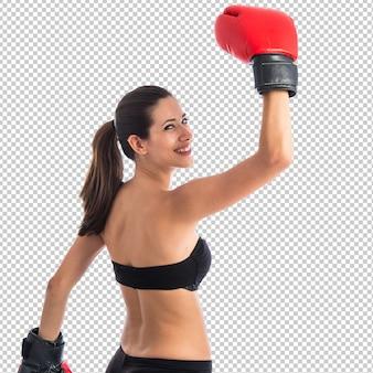 Mujer feliz del deporte con los guantes de boxeo