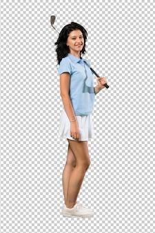 Mujer joven golfista sonriendo mucho