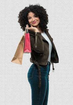 Mujer joven, tenencia, bolsas de compras