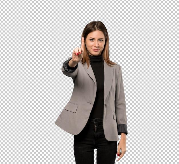 Mujer de negocios que muestra y que levanta un dedo