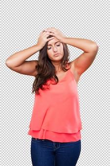 Mujer que tiene un dolor de cabeza