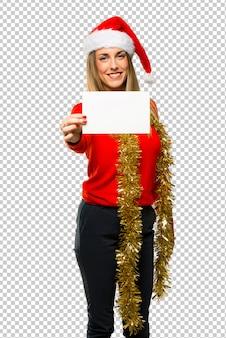 Mujer rubia vestida para vacaciones de navidad