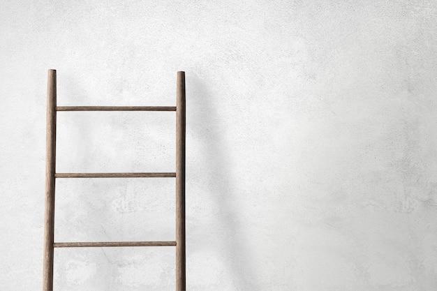 Muurmodel psd met een ladder die erop leunt