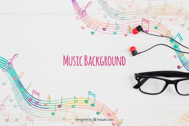 Muzieknotenachtergrond en glazen