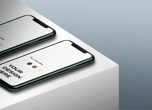 Nieuwe smartphones mockup naar boven op tafel