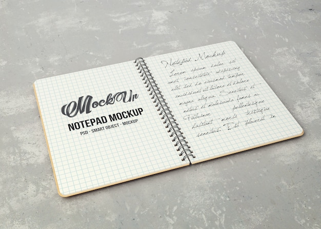 Notebook aperto con fogli bianchi mockup