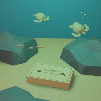 Océano día vida marina y caja de cartón bajo el agua