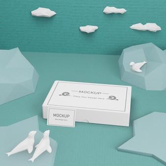 Océano día vida marina y caja de cartón con maqueta
